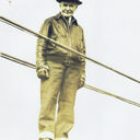 Holton Duncan Robinson at age 78 walking a suspension bridge cable.From the private collection of Ann Robinson Henshaw