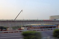 Structures of the Beijing-Shanghai high-speed rail line under construction along the highway between Nanjing and Shanghai