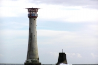 Current Eddystone Lighthouse next to the foundations of the older tower designed by John Smeaton
