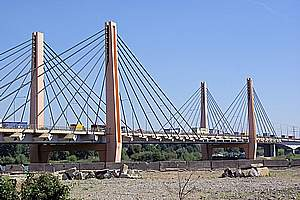 Cable-stayed bridges with semi-fan system