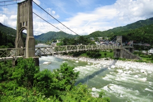 Self-anchored suspension bridges with cable-stays
