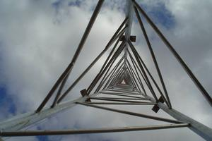 Cable-stayed steel truss masts with triangular section