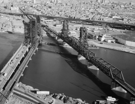 Aerial view of the PATH transit system bridge looking southeast. To the left are the Newark turnpike and the Conrail bridge. The Pulaski skyway is in the background