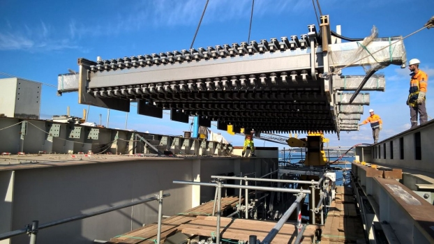 Lift in of the first 28 profile expansion joint at the South end of the Izmit Bay Bridge in mid-May: Type MAURER DS 2800 F2, 100 mm gap width and a total width of 25.40 m. Already in service stage, the expansion joints with 28 lamellas accommodate movements of +/- 1,400 mm. In case of a 500 year seismic event they can accommodate +/- 3,770 mm. The 4 m additional displacement is facilitated by a fusebox, which can be considered as a safety valve