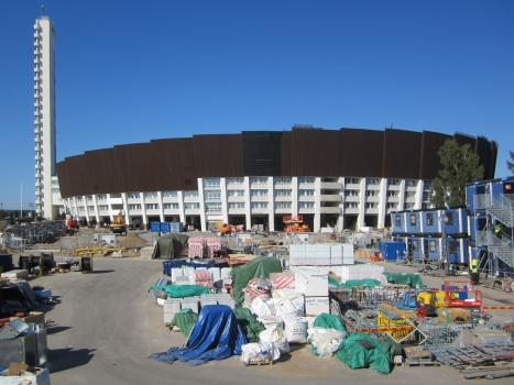 Helsinki Olympic Stadium with building site storage in front of the listed and renovated façade.