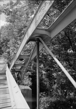 """Shaw Bridge : Detail of south span showing manufacturer's plate: """"J.D. Hutchinson, Builder Troy NY. 1870"""" and connector bolt below it."""