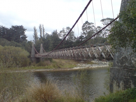 The Clifden Suspension Bridge in Southland, New Zealand. Looking roughly southwest