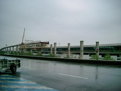 Charles de Gaulle Airport. High-level access ramp under construction in front of nearly completed Terminal 2E