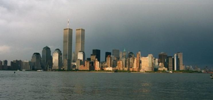 New York City skyline dominated by the twin towers of the World Trade Center.