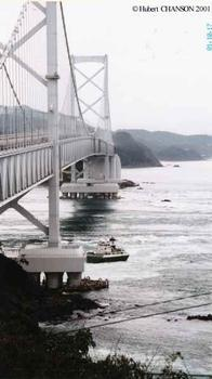 Ohnaruto Bridge seen from the southern abutment. Freighter shown was trapped in the whirpool vortices and grounded during the ebb flow