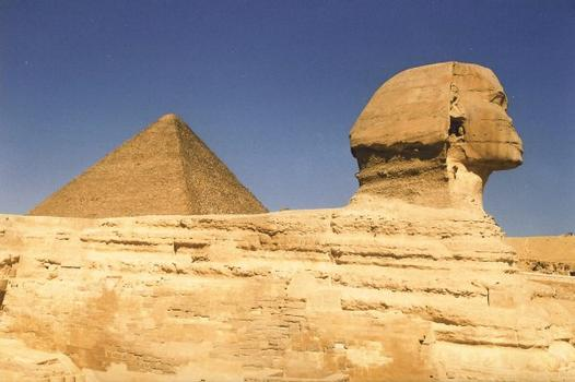 Side view of the Sphinx with the Pyramid of Cheops in the back