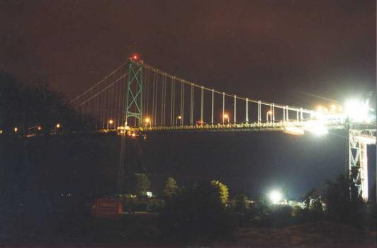 Rehabilitation of Lions Gate Bridge Cutting the old Deck at Nighttime