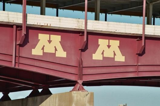 View of the Washington Avenue Bridge. The «M» is for the University of Minnesota. The bridge also connects the campus which stradles both banks of the Mississippi River