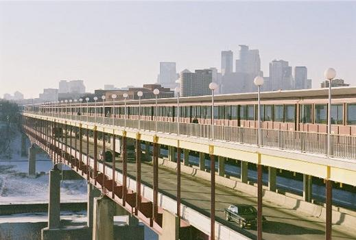 View of the Washington Avenue Bridge. Pedestrians and bicyles on top; cars and trucks below. This bridge connects the campus of the University of Minnesota, which stradles the Mississippi river