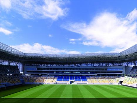 Blick auf die Westtribüne und das Stadiongebäude. In Arena Lviv sind die Sitzreihen so angeordnet, dass jeder Zuschauer eine optimale Sicht auf das Spielfeld hat. Alle Ränge liegen witterungsgeschützt unter dem teilweise transparenten Stadiondach.