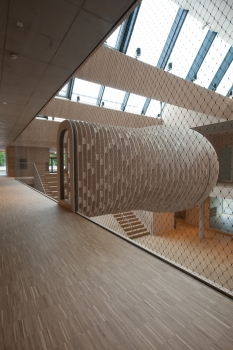 A wooden cocoon hanging from the ceiling is an eye-catcher in the foyer of the new Kinderhaus in the Riedlepark. : A wooden cocoon hanging from the ceiling is an eye-catcher in the foyer of the new Kinderhaus in the Riedlepark.