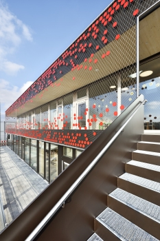 From a distance, red sequins adorn the façade of the St. Nikolaus childcare centre in the Bavarian town of Eibelstadt.