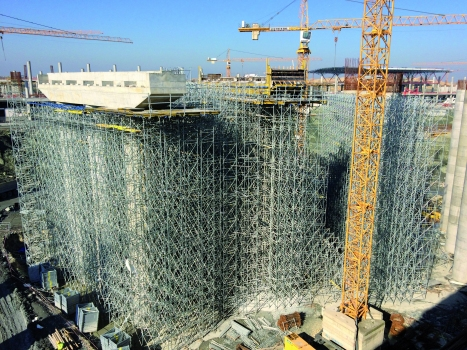 In all, 30,000 tower frames and 100,000 running m of timber formwork beams are in use on this construction site.  : In all, 30,000 tower frames and 100,000 running m of timber formwork beams are in use on this construction site.