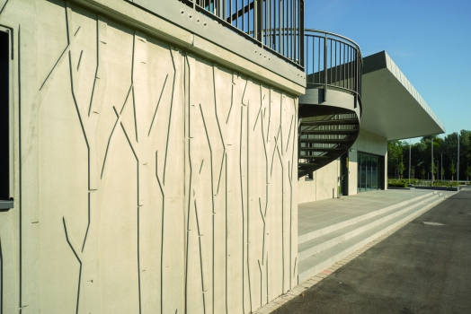 After the sample panels were cast, the architect decided in favour of the raised, stylised riparian woodland motif.  : After the sample panels were cast, the architect decided in favour of the raised, stylised riparian woodland motif.