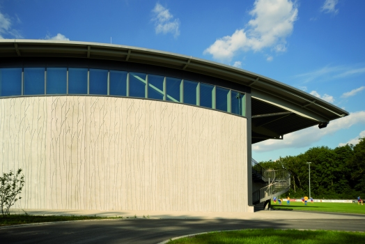 The exposed concrete surfaces of the Auwald Sports Centre in Gundremmingen are modelled on the features of a riparian woodland.  : The exposed concrete surfaces of the Auwald Sports Centre in Gundremmingen are modelled on the features of a riparian woodland.