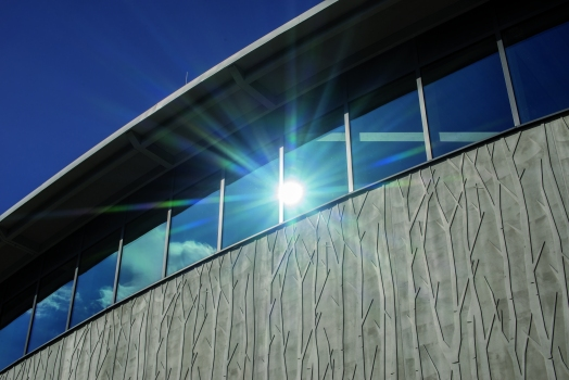 "Textured concrete surfaces such as these at the Auwald Sports Centre in Gundremmingen are ""brought to life"" by the interplay of light and shadow"