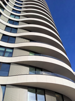 The balconies help to create a continuous organic shape.