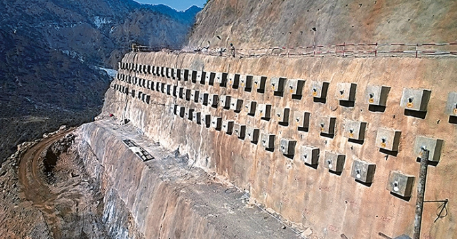 The Chenab Valley's massive slopes have angles between 43° and 77° and are stabilized by a double corrosion protected bar anchor system
