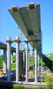 Cantilevering is the construction method for the haunched, twin-cell pre-stressed box girders of the superstructure of this 450 m long girder bridge.