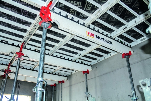 Early striking with the drophead system reduced on-site material requirements of the slab formwork. : Early striking with the drophead system reduced on-site material requirements of the slab formwork.