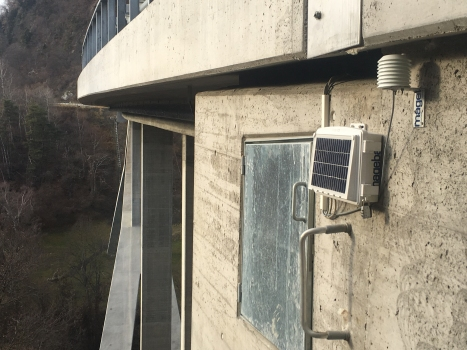 The heart of the SHM system, installed externally at one abutment of the Lavoitobel Bridge, complete with integrated solar panel on its cover for power supply and a separate weather sensor