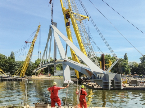 The two prefabricated main elements of the steel bridge were positioned using three floating cranes. : The two prefabricated main elements of the steel bridge were positioned using three floating cranes.