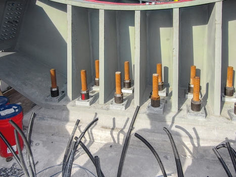 Five groups of 20-24 post-tensioning bars are embedded multiple feet in to each pier cap.