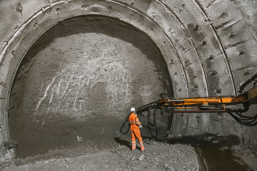 A thick shotcrete lining is being applied.