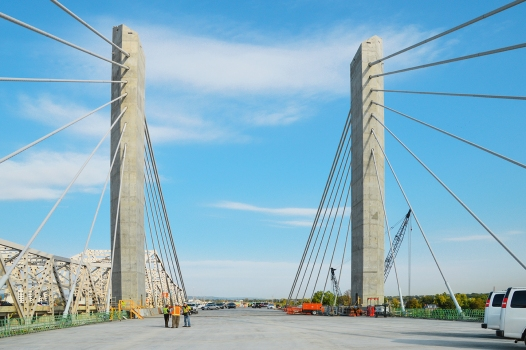 The bridge consists of two 228.6 m (750 ft) long main spans and two 92.35 m (303 ft) long side spans. : The bridge consists of two 228.6 m (750 ft) long main spans and two 92.35 m (303 ft) long side spans.