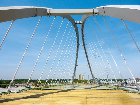 The two large arch ribs are tilted towards one another and meet in the middle of the main span. : The two large arch ribs are tilted towards one another and meet in the middle of the main span.