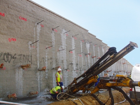 To increase their load-bearing capacity, the retaining walls were tied back using self-drilling hollow bar anchors.  : To increase their load-bearing capacity, the retaining walls were tied back using self-drilling hollow bar anchors.