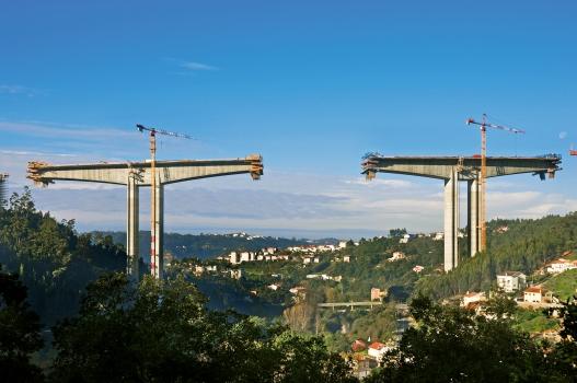 A picturesque landscape surrounds the bridge.
