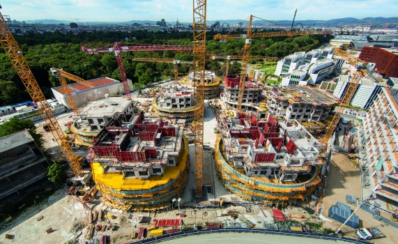 Situated next to the famous Vienna Prater amusement park, seven distinctive and up to 33 m high residential towers are currently being realized