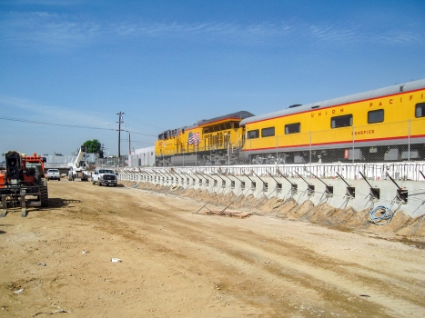 Long wait times at the railroad crossings and the ensuing environmental impact will be eliminated by the San Gabriel Trench.  : Long wait times at the railroad crossings and the ensuing environmental impact will be eliminated by the San Gabriel Trench.