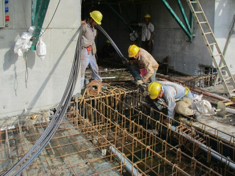 The tendons were used to stress 4.7 m cantilever beams and 12 m long girders.