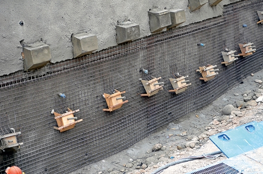 Drill anchors before being stabilized by reinforced concrete