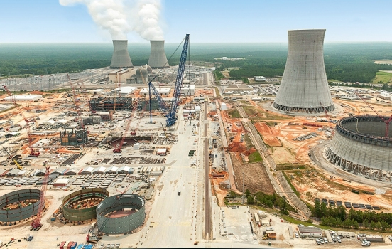 Construction site of Plant Vogtle Units 3 and 4; in the background, Units 1 and 2 are steaming.