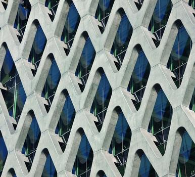 A filigree reinforced concrete net covers the glass façade of Prosta Tower in Warsaw