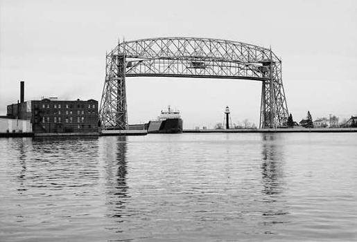Aerial Lift Bridge : South elevation of bridge, with the ore boat the 'Roger Blough' approaching   (HAER, MINN,69-DULU,9-3)