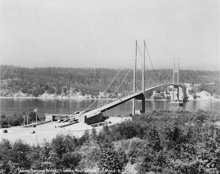 "Tacoma narrows bridge, looking west across Toll plaza, 29 august 1940. (Eldridge, Clark H. ""Tacoma Narrows Bridge, Tacoma, Washington, Final Report on Design and Construction,"" 1941) (HAER WA-99-31)"