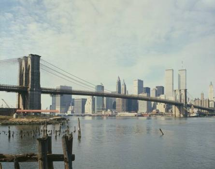 Brooklyn Bridge: View looking west from Brooklyn shore with pier pilings in left foreground   (HAER, NY,31-NEYO,90-77)