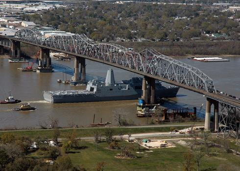 The Pre-Commissioning Unit New Orleans (LPD 18) transits under the Huey P. Long Bridge on the Mississippi River towards New Orleans, La., March 5, 2007, for a March 10 commissioning ceremony. The San Antonio-class amphibious transport dock will functiona lly replace more than 41 classes of amphibious ships, providing the Navy and Marine Corps with modern, sea-based platforms. (U.S. Navy photo by Mass Communication Specialist 1st Class Shawn Graham)