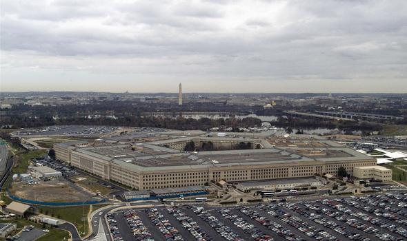 An aerial view of the Pentagon, the headquarters of the United States Department of Defense (DoD) located between the Potomac River and Arlington National Cemetery. The Pentagon employs approximately 23,000 military and civilian personnel and is one the world's largest office buildings with three times the floor space of the Empire State Building in New York City (NYC). In the background the obelisk of the Washington Monument is visible