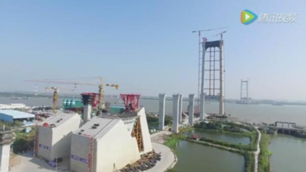 Humen 2nd Bridge under construction建设中的虎门二桥 : Humen 2nd bridge, two main span 1688m,1200m,width 42m,is the largest double main span suspension bridge in the world.Located between Dongguan and Panyu,Guangdong province: 虎门二桥,两主跨分别1688米,1200米,宽42米八车道,是世界最大的双主跨悬索桥。位于广东省东莞市和番禺区之间的珠江口: https://zh.wikipedia.org/wiki/%E8%99%8E%E9%97%A8%E4%BA%8C%E6%A1%A5 http://www.takungpao.com.hk/mainland/text/2016/1011/29999.html https://www.youtube.com/playlist?list=PLE3LV1t4ql0MiLXaERT-xhAuskOaF5VHB
