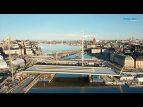 An Innovative Solution for a Special Bridge - The Stockholm Slussen Project : 140 meters in length, 45 meters wide and 3,400 metric tons. And gold colored. The new bridge in Stockholm is definitely set to be a new landmark in Sweden's capital city. It's a project that has challenged even the most experienced design engineers.  In order to handle the movements generated in the bridge, Ramboll has chosen to have hinged columns with Expander System axles from the Nord-Lock Group as struts. ` Read the Bolted article about this case: https://www.nord-lock.com/insights/customer-cases/2020/special-bridge/ -------------------------- Nord-Lock Group is a global leader in bolted solutions. Our innovative technologies combined with our industry-leading expertise secures millions of critical applications across the globe. The product portfolio includes Nord-Lock® wedge-locking washers, Superbolt™ mechanical tensioners, Boltight™ hydraulic tensioners and Expander® System pivot pins. Our solutions are developed and manufactured in-house. Follow us! Website: https://www.nord-lock.com Blog: http://www.bolted.com LinkedIn: https://www.linkedin.com/company/nordlockgroup Facebook: https://www.facebook.com/nordlockgroup Twitter: https://twitter.com/nordlockgroup Instagram: https://www.instagram.com/nordlockgroup